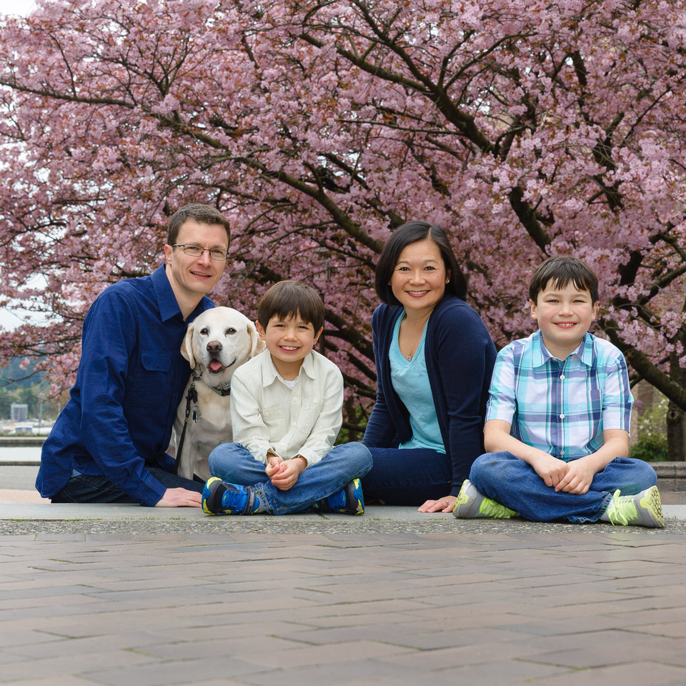 Kirkland Family Photography with a dog under cherry trees
