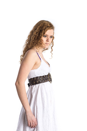 Portrait of a teenager in a white dress