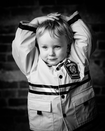 Toddler with a fireman jacket