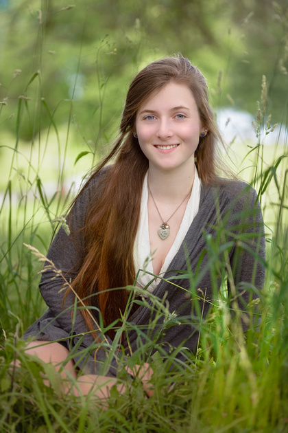 Senior picture - Seated in tall grass