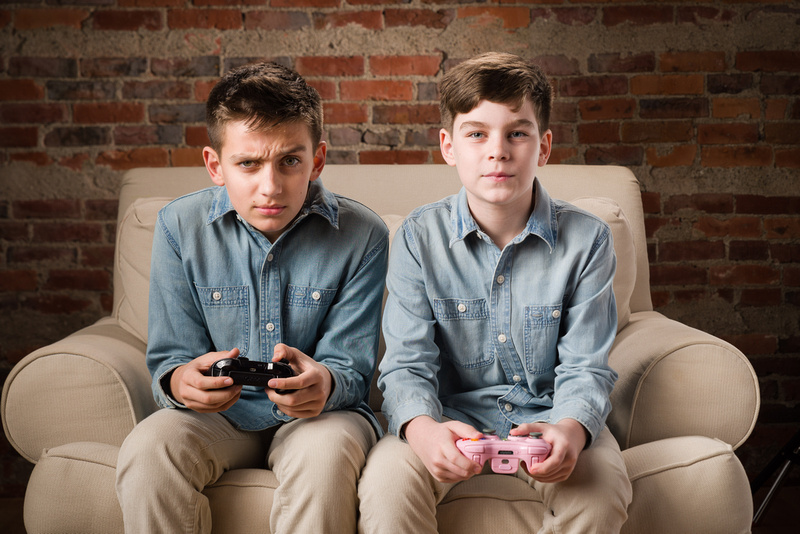 2 tween boys playing on XBox