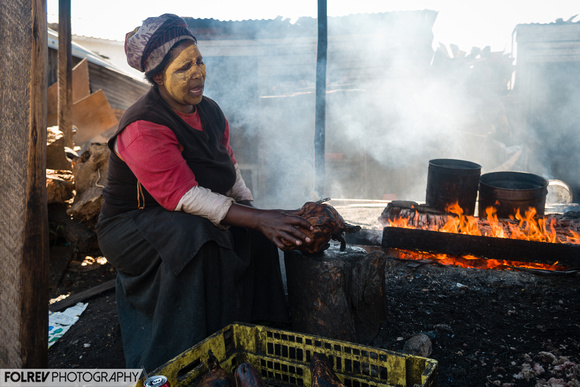 Cooking sheep heads in a township